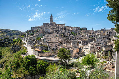 """Deep in southern Italy, in the """"heel of the boot"""", lie the unique regions of Puglia and Basilicata.  It is an area of limestone ridges, fertile valleys, vineyards, ancient olive groves and pretty towns.  We explore the rock-cut dwellings in UNESCO-protected Matera, the dry-stone houses of Alberobello and the dramatic coastline, while enjoying the great regional cuisine and wines."""
