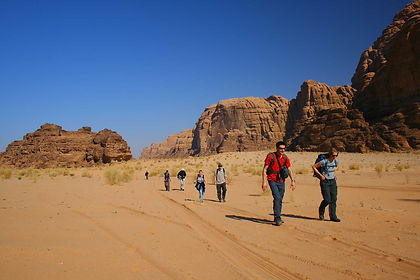 "Described by T.E. Lawrence as ""vast, echoing and God-like..."", it is at Wadi Rum that red sandstone rocks reach up from the desert floor to the high desert sky.  The area is at its most dramatic early and late in the day, when the soft light and blue sky create a coppery effect on the sand.  Here you hike through canyons and wadis, camping like the local Bedouin among the rock formations.  Imagining ancient caravans of spice traders travelling far and wide to sell their wares, you walk into Petra, the Rose Red City hewn from the rock.  Here you discover tombs, temples and treasuries, and as you climb up to find magnificent views and vistas, you begin to understand why Lawrence loved this land."