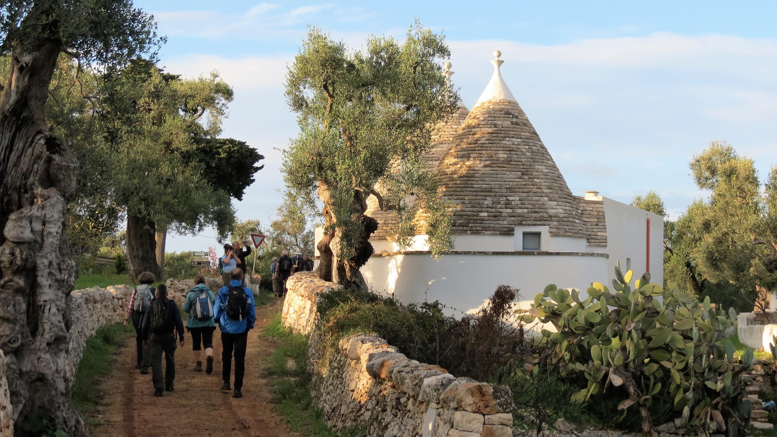 Walking past a trullo, Puglia