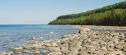 Enjoy the best day hikes on Ontario's Bruce Peninsula, following clifftop trails along stunning Georgian Bay.  This is where Adventure Coordinators maintains a portion of the famous Bruce Trail and you will hike it on day 3.  With limestone cliffs dropping off deep into azure-blue waters, on a sunny day you will believe you are in the Mediterranean rather than in Canada.