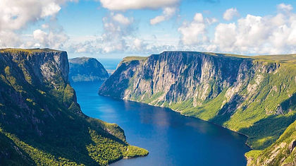 Newfoundland's Gros Morne National Park needs little introduction - virtually every Canadian knows the iconic image of Western Brook Pond, a boat tour on which is included in your vacation. This tour takes you on the best day hikes in the park, including the Look Out Hills and the summit of Gros Morne Mountain.