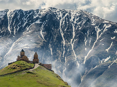 Journey through the Caucasus, home to some of the oldest Christian cultures on Earth.  Start in the capital of Armenia, Yerevan, and visit the monasteries the country is famous for: Khor Virap, Noravank and Geghard.  Drive by Lake Sevan and visit medieval churches en-route to Georgia's capital Tbilisi. In Georgia, enjoy stupendous views along the Georgian Military Highway and  walk up through the village of Gergeti to the Holy Trinity church, set against the backdrop of Mount Kazbek.  Visit Gori, the birthplace of Joseph Stalin, walk in some beautiful areas, explore the rock-hewn town of Uplistsikhe and try some of the wine the country is famous for.