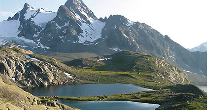 High up in the Alps' Aosta Valley, against the border with France, Gran Paradiso, Italy's oldest national park, feels like a true wilderness.  Encounters with ibex and chamois are common on your trek and the views of Mont Blanc and as far over as Matterhorn are simply stupendous.  Glacial lakes, valleys carpeted in wildflowers and snow-covered mountains set the back-drop for a week of fantastic hiking.  Nights are spent in atmospheric mountain refuges, adding to the alpine experience.