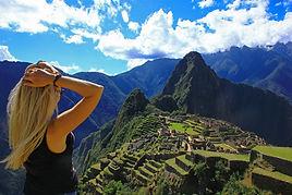 Young woman looking at Machu Picchu. Aer
