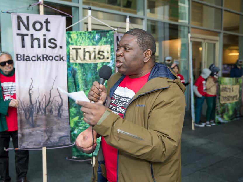 2019 Goldman Environmental Prize winner and environmental lawyerAlfred Brownell speaking outside BlackRock headquarters in San Francisco.