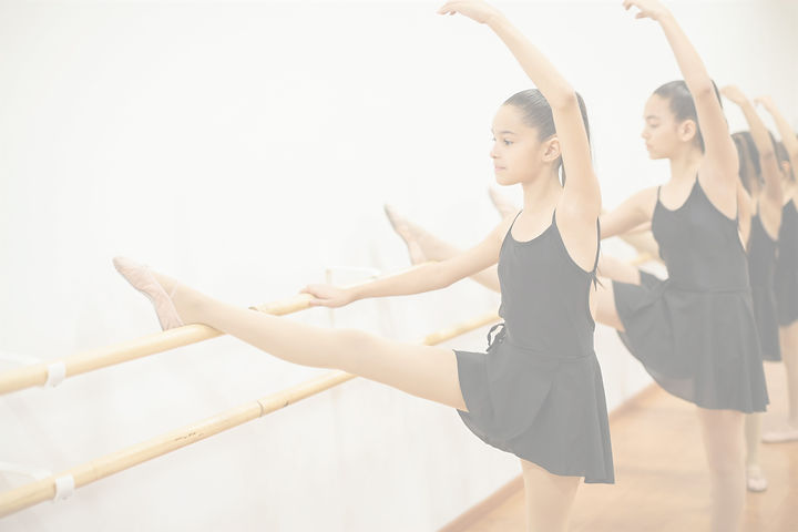 Cute%20girl%20in%20a%20leotard%20and%20skirt%20lifting%20her%20leg%20and%20arm%20during%20a%20ballet