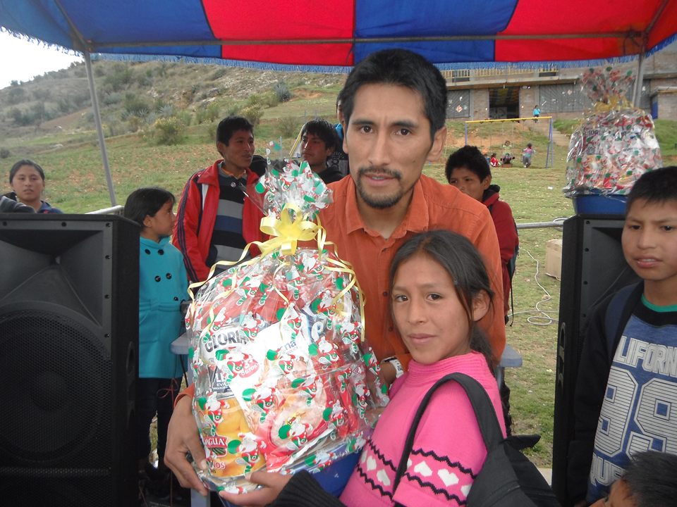 giving food in christmas 2015 for the family of the poor children