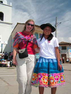 volunteer and peruavian girl with a tipical cloth from the andeans_edited