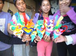 children showing their works
