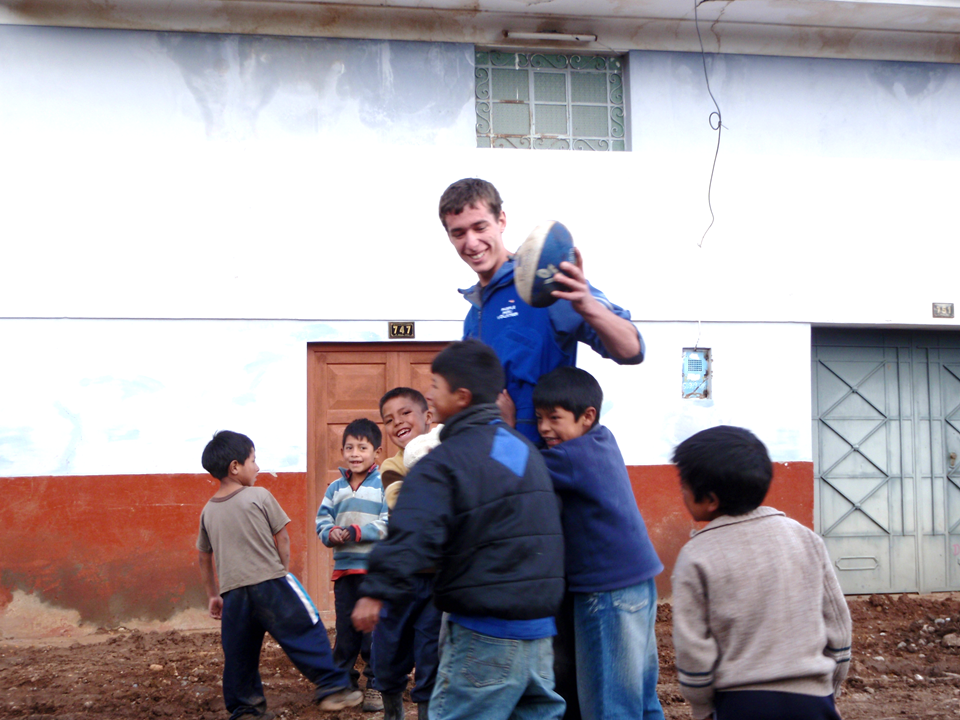 He is Paul from Australia playing with children