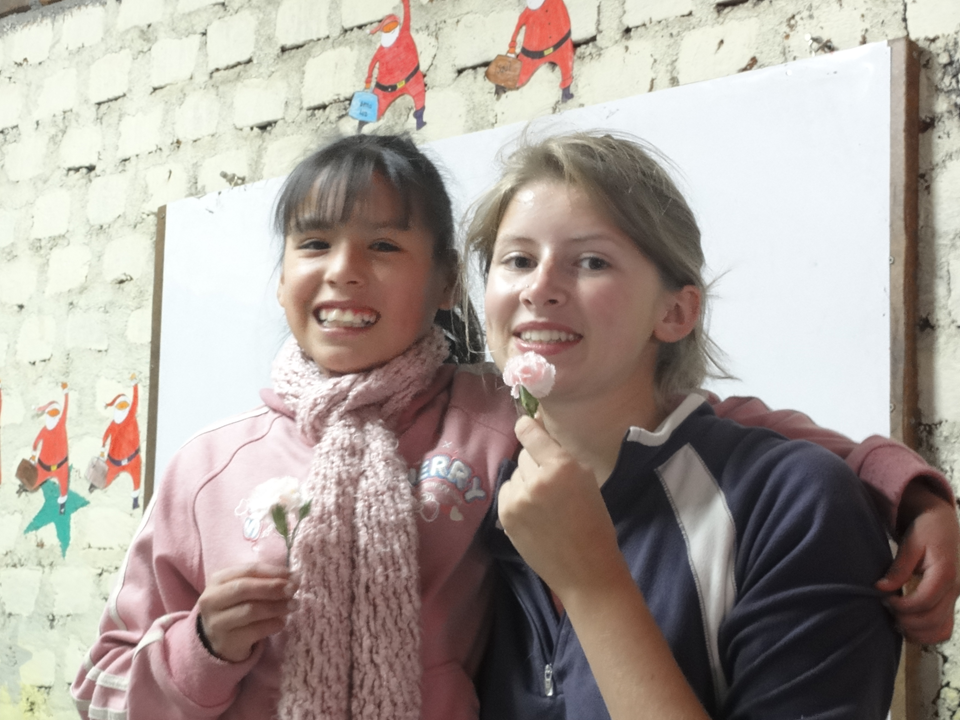 student and volunteer with flowers