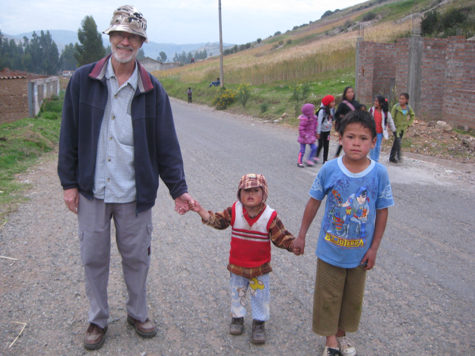 Lance going with children to the ruins near the school