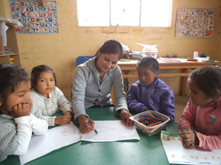 Margot is a peruvian volunteer she is teaching to the 3 to 5 yer pld students.