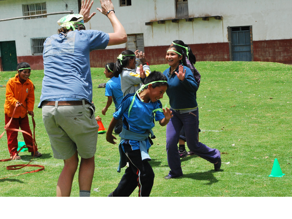 children and volunteers playing