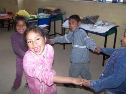 children dancing taking hands