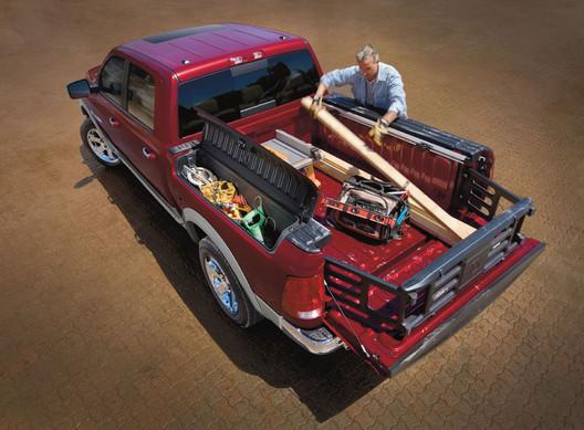 dodge-ram-1500-red-truck-worker-loading-