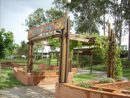 Koala Park Community Garden arbor and raised garden beds