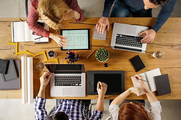 bigstock-Top-view-of-team-working-on-bl-144818444.jpg