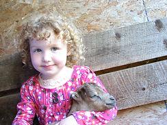maisie with baby goat.jpg
