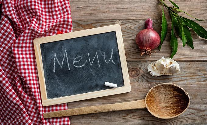 menu-text-on-a-blackboard-herbs-and-a-la