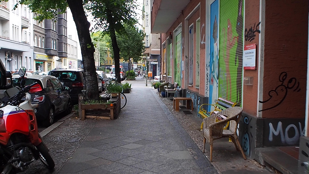 Benches and chairs at a section of Bürknerstraße