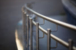 Chromium metal fence with handrail. Shallow depth of field. Selective focus..jpg
