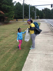 Mother and daughter giving back
