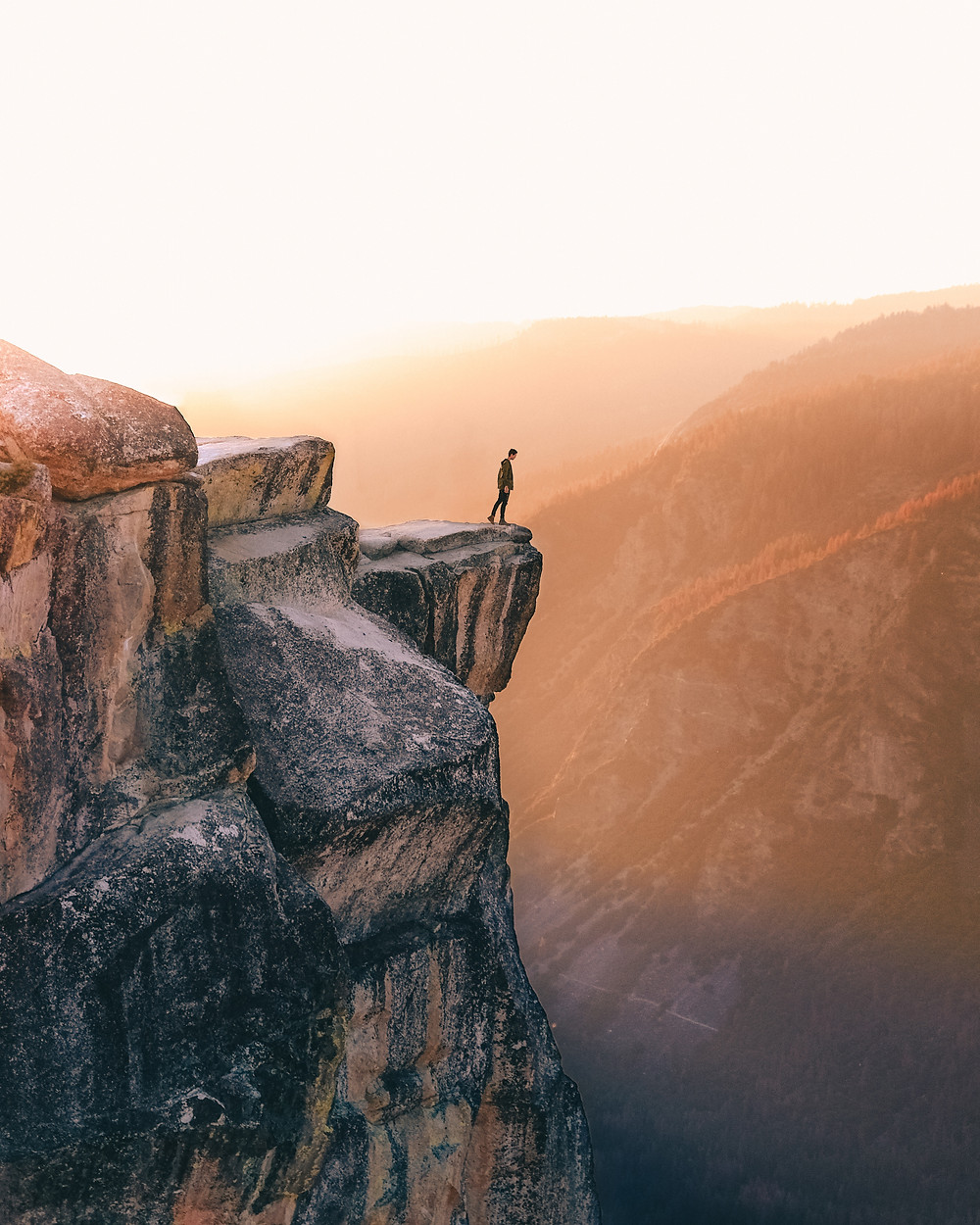 Photo: person standing on the edge of a cliff Photo by Leio McLaren on Unsplash