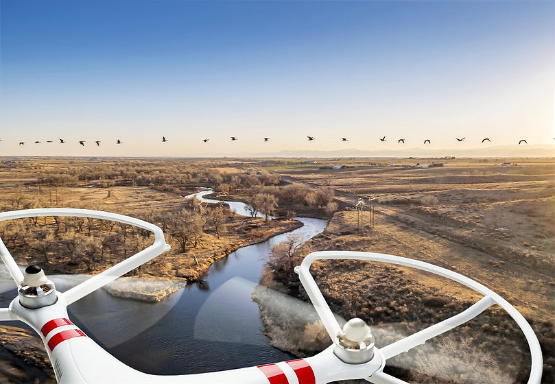 Drone%20over%20a%20River_edited.jpg