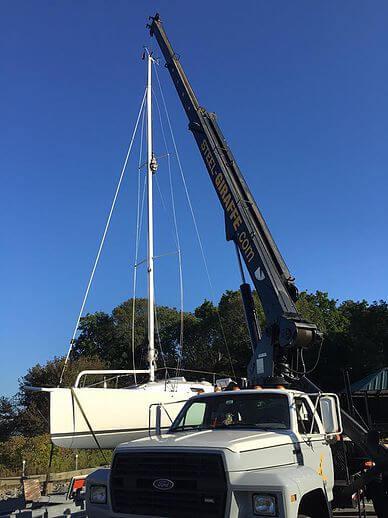 Mast unstep using crane
