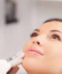 Cheerful young woman is getting botox pr