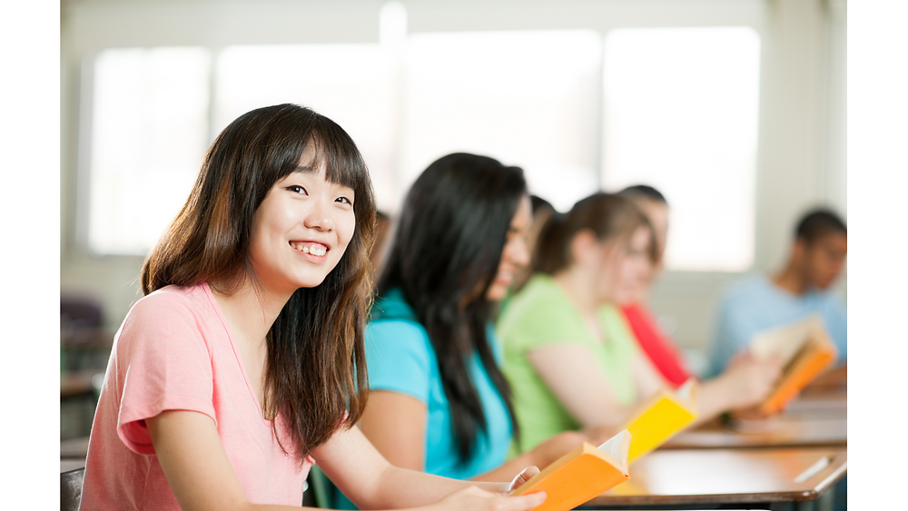 happy students in a tuition centre in Singapore