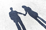 Shadow of a man and woman holding hands