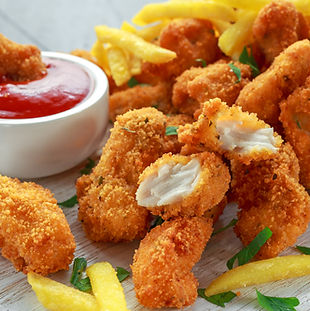 Fried crispy chicken nuggets with french
