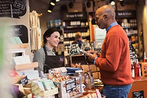 Key-Smiling owner talking to customer ho