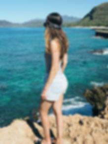 girl wearing boho headband on the beach