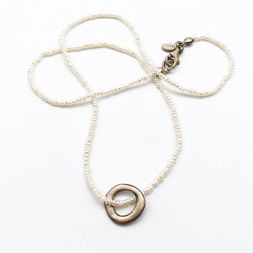Strand of Seed Pearls with Silver Pendant