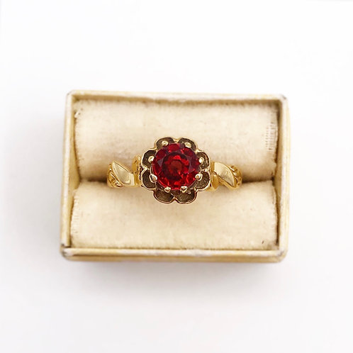 Solitaire Garnet Ring in a Buttercup Setting