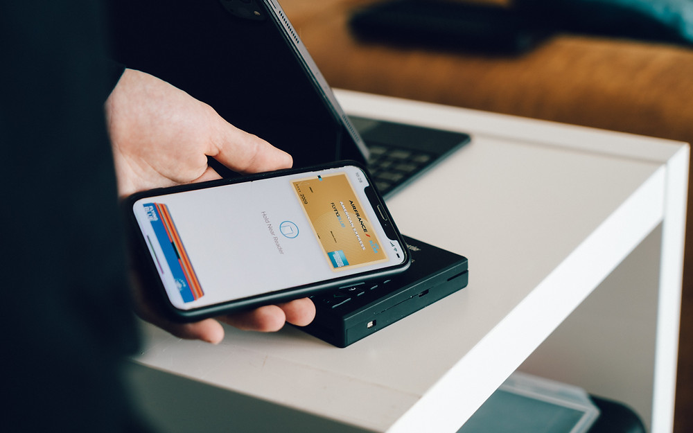 Image of person paying for a service on their cell phone with credit card