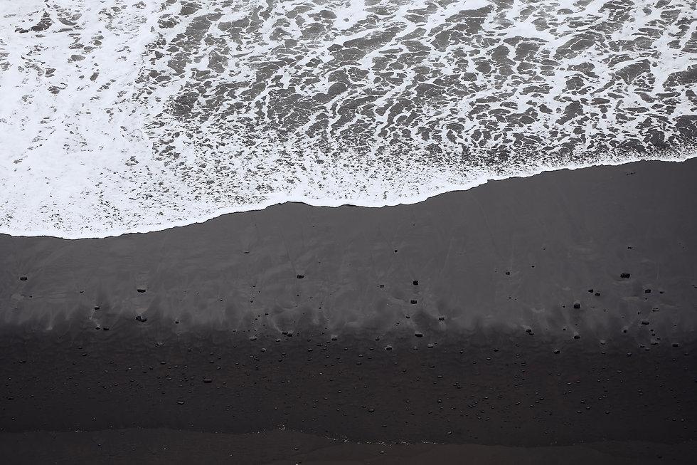 waves-on-black-sand-beach-in-tenerife-43T3F7W.jpg