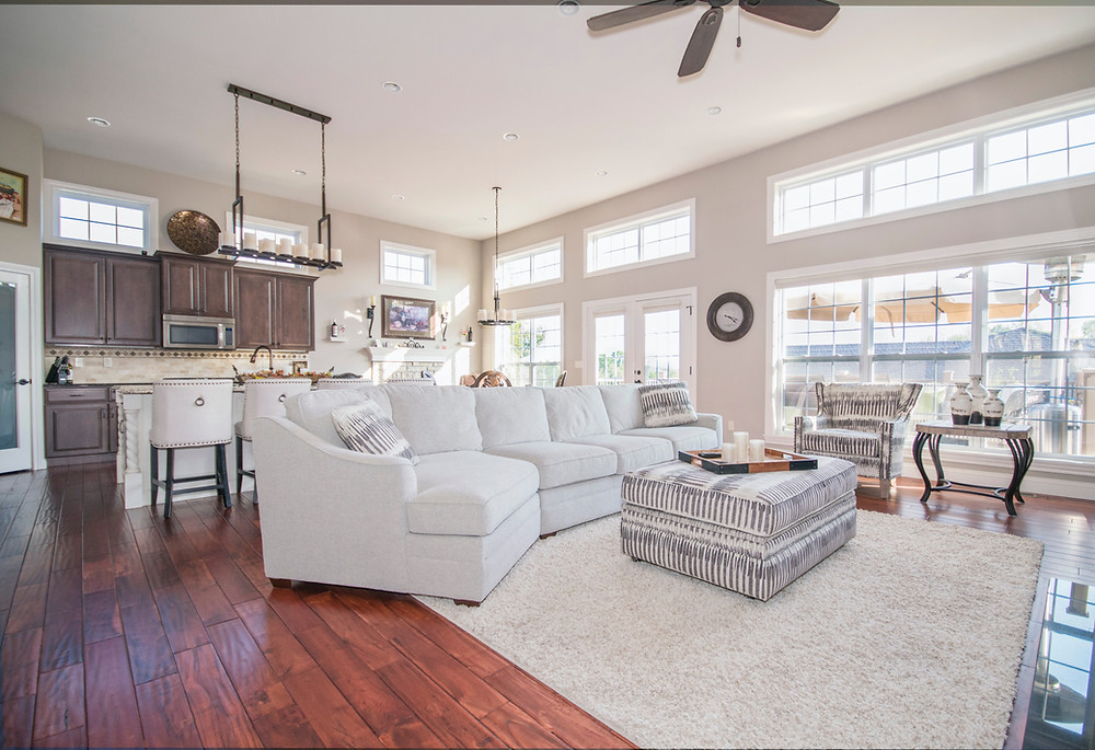 This is a great example of a grand open living space. It includes the kitchen, living room and dining room and is well furnished!