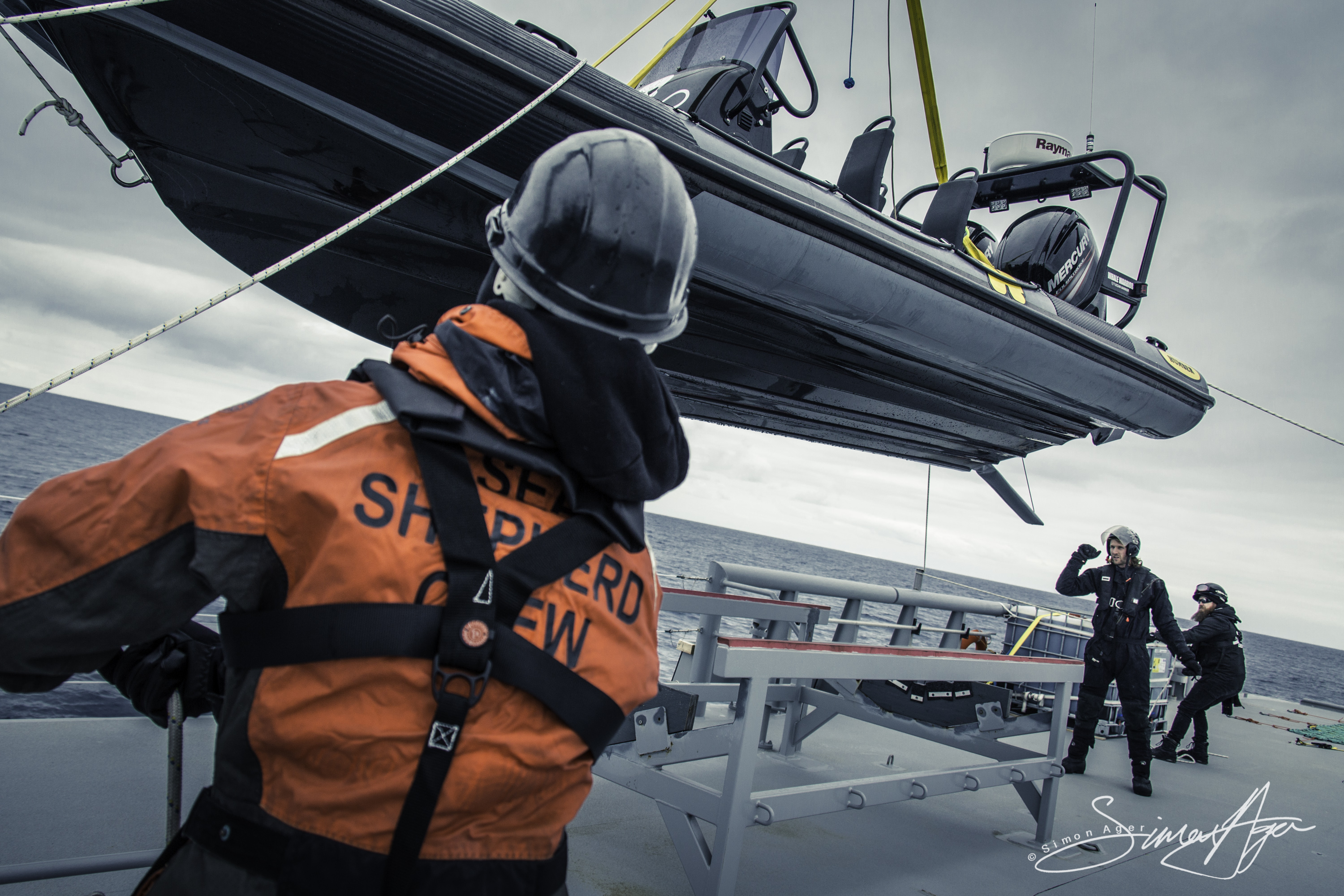 170112-SA-OW-Deck-crew-on-lines-retrieve-small-boat-006-4802