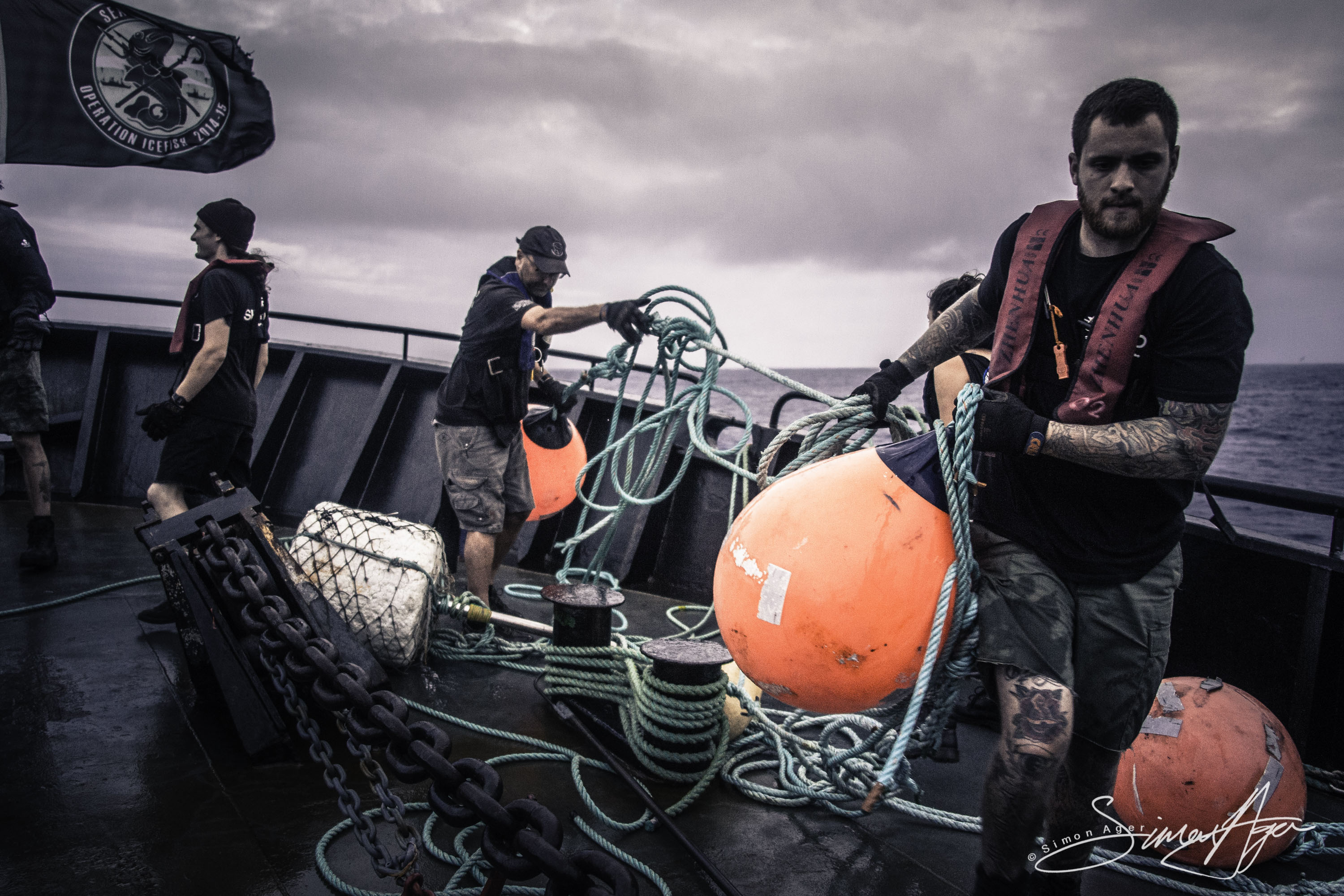 150207-SA-147-BB-deck-crew-retrieve-bouys-after-Thunder-starts-setting-net