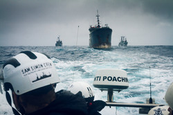 150214-SA-BB-SS-escort-illegal-vessel-Thunder-2684