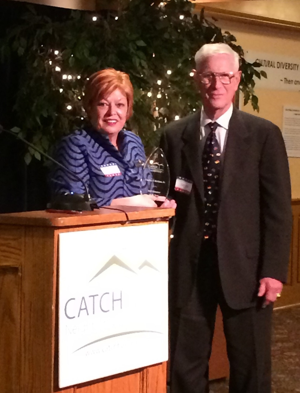 Rosemary presents Chuck Gerhan with the Volunteer of the Year Award