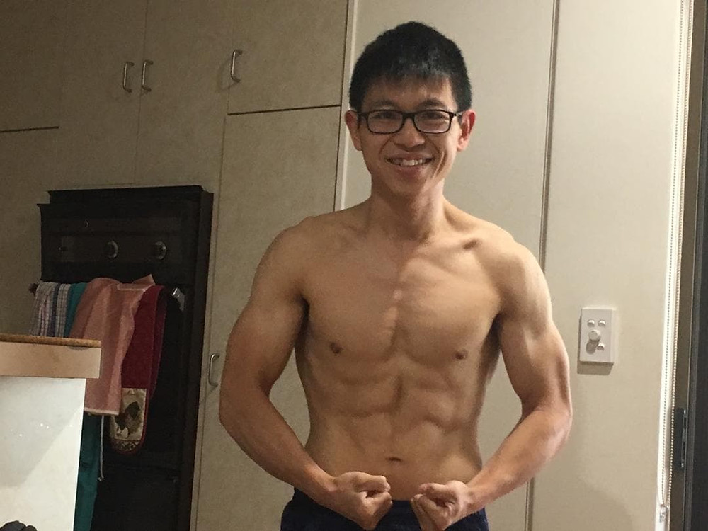 A frontal shot of Liang shirtless to show off his weight loss progress.
