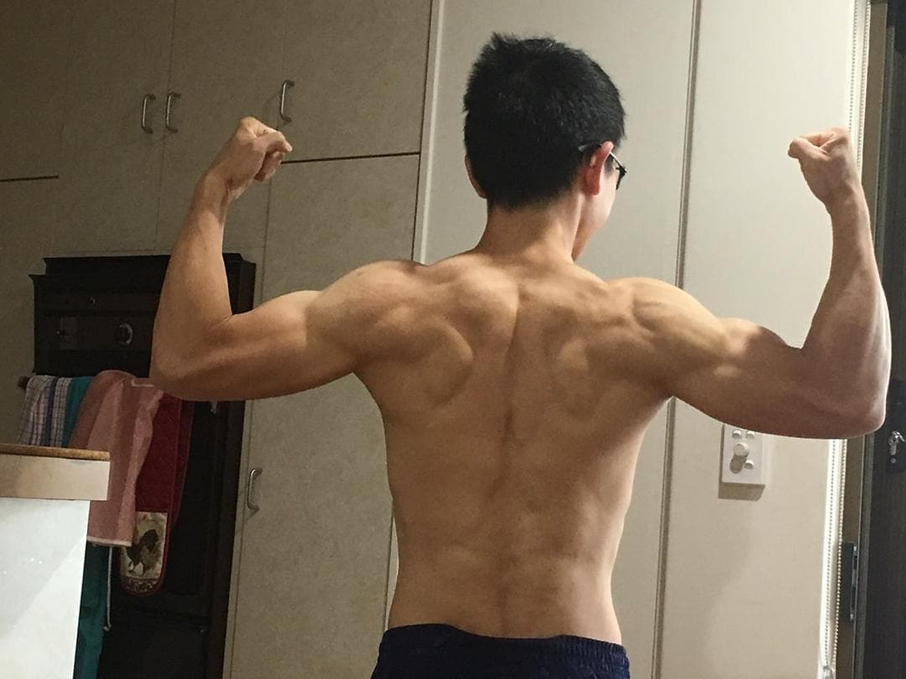A shot of Liang shirtless from behind to show off his weight loss progress.