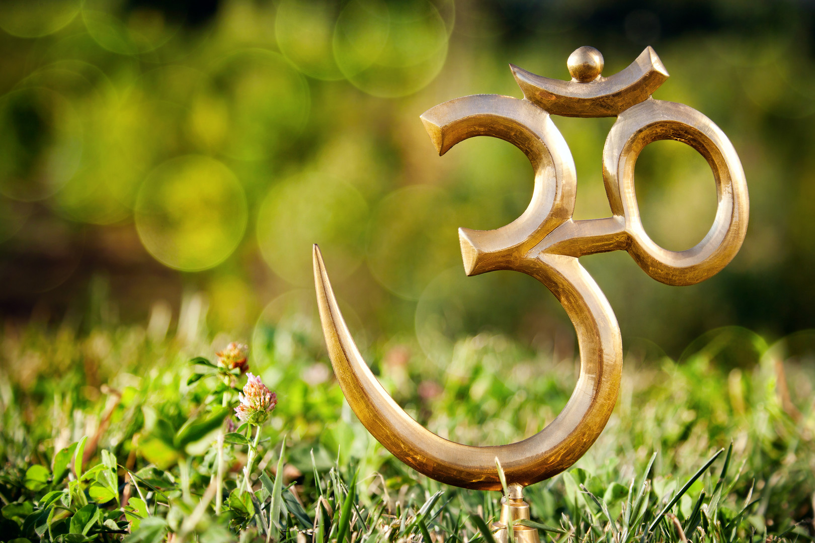 Om Statue On The Grass.jpg