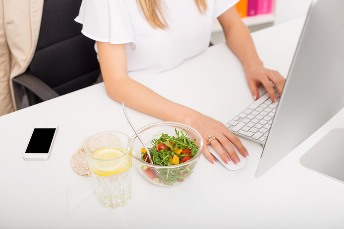 woman in the office with healthy lunch.j