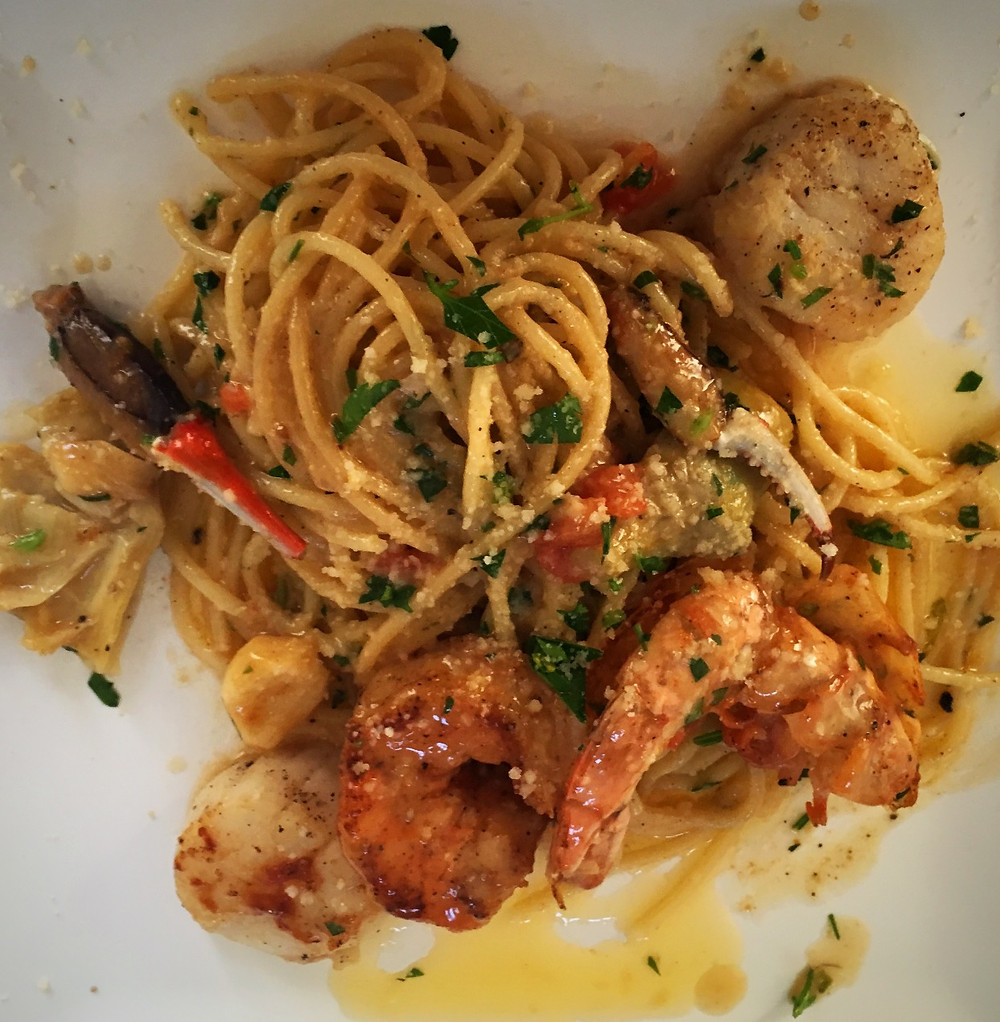Scallops and shrimp in brown garlic butter